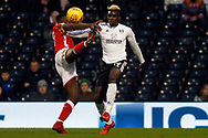 Sheyi Ojo of Fulham (R) fends off Mamadou Thiam of Barnsley (L). EFL Skybet championship match, Fulham v Barnsley at Craven Cottage in London on Saturday 23rd December 2017<br /> pic by Steffan Bowen, Andrew Orchard sports photography.