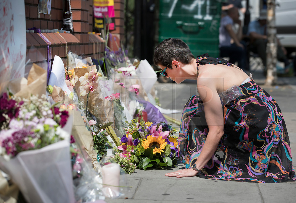 © Licensed to London News Pictures. 20/06/2017. London, UK. A woman pauses in thought after placing flowers outside Finsbury Mosque in north London after a van ploughed into a crowd nearby. One person has been killed and 10 people are injured. Darren Osborne, 47, from Cardiff, continues to be held on suspicion of attempted murder and alleged terror offences.  Photo credit: Peter Macdiarmid/LNP