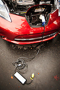 """An """"emergency"""" charger which uses 120 volt household electrical current will charge the forty eight lithium ion batteries from zero to 100% . in 18 hours. Nissan says that the charger is used as a backup when conventional residential or commercial fast chargers aren't available."""
