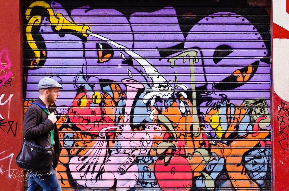 Man and graffiti, Paris, France