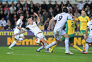 Swansea City's Jonjo Shelvey has a shot at goal blocked.<br /> UEFA Europa league match, Swansea city v FC Kuban Krasnodar at the Liberty Stadium in Swansea, South Wales on Thursday 24th October 2013. pic by Phil Rees, Andrew Orchard sports photography,