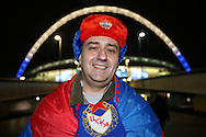 a CSKA Moscow fan poses for a photo outside Wembley Stadium before k/o. UEFA Champions league match, group E, Tottenham Hotspur v CSKA Moscow at Wembley Stadium in London on Wednesday 7th December 2016.<br /> pic by John Patrick Fletcher, Andrew Orchard sports photography.