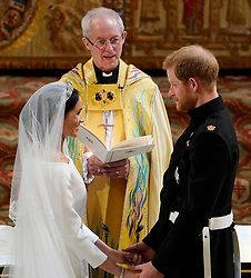 File photo dated 19/05/18 of the Duke and Duchess of Sussex as they exchange vows in St George's Chapel at Windsor Castle during their wedding service, conducted by the Archbishop of Canterbury Justin Welby. The royal couple have issued a personal message on their future.