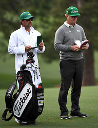 Caddie Brett Waldman, left, and golfer Charley Hoffman, right, look over their yardage books along the 17th fairway during first-round action of the Masters Tournament at Augusta National Golf Club on Thursday, April 6, 2017, in Augusta, Ga. Hoffman finished the round at -7. (Photo by Jeff Siner/Charlotte Observer/TNS) *** Please Use Credit from Credit Field ***