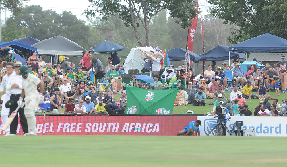 Pretoria 26-12-18. The 1st of three 5 day cricket Tests, South Africa vs Pakistan at SuperSport Park, Centurion. Day 1. Afternoon session. Spectators battle with an upturned umbrella as a gust of wind came through the stadium<br /> Picture: Karen Sandison/African News Agency(ANA)