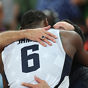 Lebron James, USA, hugs coach Michael Krzyzewski during the Men's Basketball Final between USA and Spain at the North Greenwich Arena during the London 2012 Olympic games. London, UK. 12th August 2012. Photo Tim Clayton