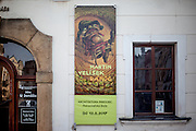 """Road trip with """"U vystřelenýho oka"""" to the Martin Velisek retrospective exhibition in Pardubice. Martin Velíšek (Duchcov, Czechoslovakia, October 21, 1963) is a popular Czech artist whose work spans the media of glass and canvas, animated film, album covers, book covers, restaurant menus, napkin packaging, TV packaging, photography, sculpture, and interiors (Wiki). Velisek also designed the interior of the famous pub """"U vystřelenýho oka"""" in Zizkov."""