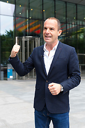 """© Licensed to London News Pictures. 16/05/2018. London, UK. MARTIN LEWIS arrives at Facebook offices in London. TV and radio presenter, Martin Lewis has previously launched a High Court legal battle to """"give Facebook a bloody nose"""" and change the way it operates over claims the website has been publishing scam adverts. Photo credit: Vickie Flores/LNP"""