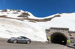 THEMENBILD - die Grossglockner Hochalpenstrasse. Die hochalpine Gebirgsstrasse verbindet die beiden oesterreichischen Bundeslaender Salzburg und Kaernten mit einer Laenge von 48 Kilometer. Sie ist als Erlebnisstrasse vorrangig von touristischer Bedeutung und das Befahren ist fuer Kraftfahrzeuge mautpflichtig, im Bild ein Auto bei der Ausfahrt des Hochtor Tunnels auf Kärntner Seite, aufgenommen am 24.05.2014 // ILLUSTRATION - the Grossglockner High Alpine Road. The high alpine mountain road connects the two Austrian federal states of Salzburg and Carinthia with a length of 48 kilometers. It is as a matter of priority road experience of tourist importance and for driving motor vehicles is a toll road. Picture taken on 2014/05/24. EXPA Pictures © 2014, PhotoCredit: EXPA/ JFK