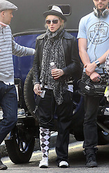 ©London News Pictures. 15/01/2011 .Picture Credit Should read Neil Hall/London News Pictures.Madonna directs her new period film W.E. starring Abbie Cornish about the abdication of King Edward in London on 08/08/2010. Madonna is pictured wearing a trendy hat and one sock rolled up