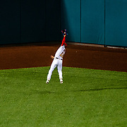 Washington Nationals outfield Victor Robles leaps to make the catch in center field before making the throw to first for a double play at Nationals Park on August 25, 2020.