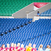 TOKYO, JAPAN  July/August: Photo Essay by Tim Clayton<br /> <br /> Football. The National Anthem. USA V New Zealand. Saitama Stadium. 15/16<br /> <br /> If the athletes are the heart of any sporting event, the soul are the spectators.Sadly, due to covid 19 restrictions spectators were banned from viewing live what has now become 'the greatest sporting show on earth' The Olympic Games. The cavernous stadiums, many of exceptional quality were left to the whispers of Olympic triumphs past, spirits and history breezing through the empty stands in an attempt to muster up a trace of emotion. The athletes performed, it was no dress rehearsal, but a calling from within to follow that Olympic spirit of faster, higher, stronger and challenge themselves on the ultimate world stage, without the support of their soul mate, the fan.The Olympic Games Tokyo 2020 were like no other… Tokyo, Japan. July August 2021 (Photo by Tim Clayton/Corbis via Getty Images)