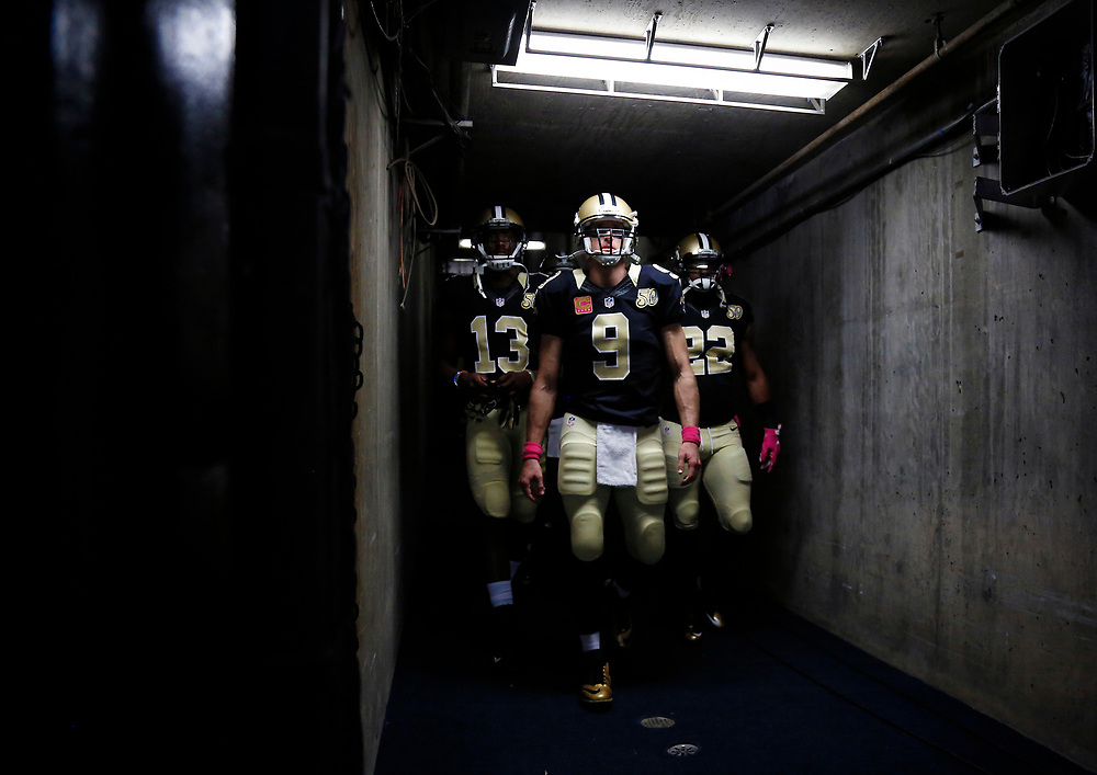 From left to right, New Orleans Saints wide receiver Michael Thomas (13), quarterback Drew Brees (9), and running back Mark Ingram (22) walk towards the field before an NFL football game against the San Diego Chargers, Sunday, Oct. 2, 2016, in San Diego. The Saints defeated the Chargers, 35-34. (Ryan Kang via AP)