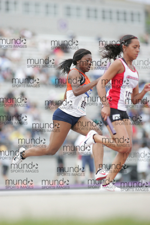 (London, Ontario}---04 June 2010) Deanna Thomas of Innisdale - Barrie competing in the senior girls 4x100m relay final at the 2010 OFSAA Ontario High School Track and Field Championships. Photograph copyright Sean Burges / Mundo Sport Images, 2010.