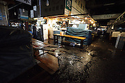 end of day, after hours, sorting and distribution area at Tsukiji Wholesale Fish Market,  Tokyo, Japan.
