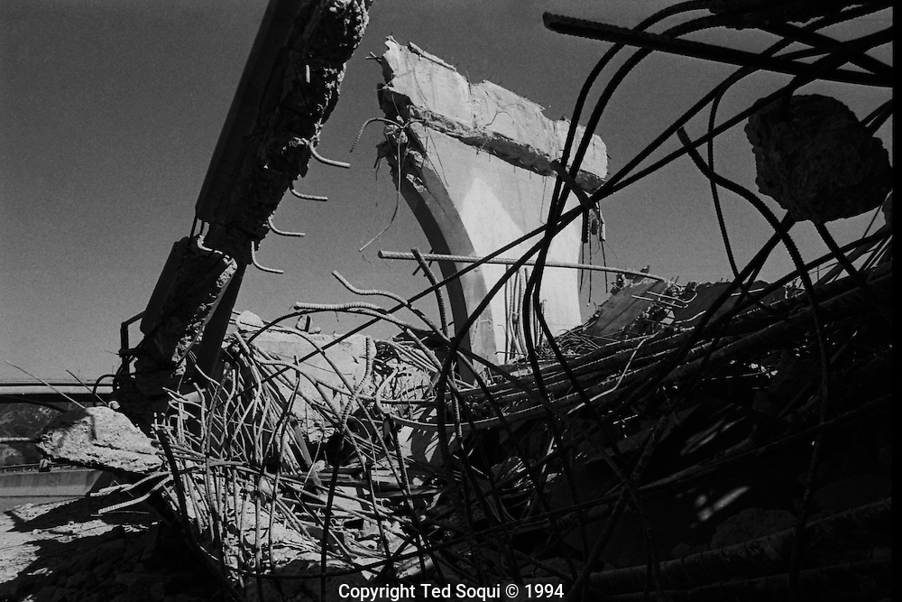 Twisted rebar and concrete at the fallen 14 freeway overpass at the I5.