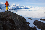 Ian Howat, glaciologist with Ohio State University, looks out over the Chugach Mountains and the main branch of the Columbia Glacier, Alaska.