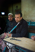 Men sit at Cafe Younis in Islamic Cairo, Egypt