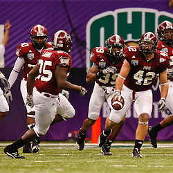 December 18, 2010; New Orleans, LA, USA; Troy Trojans linebacker Brannon Bryan (42) celebrates following an interception against the Ohio Bobcats during the second half of the 2010 New Orleans Bowl at the Louisiana Superdome. Troy defeated Ohio 48-21. Mandatory Credit: Derick E. Hingle