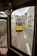 Lisbon tram line 28  seen from the inside of another 28 liner while passing through Alfama district and is the longest line of trams which cross the city.