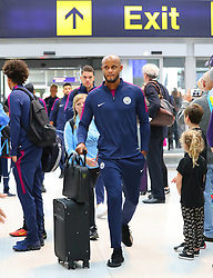 Vincent Kompany as the Manchester City team arrive at Manchester Airport as they jet for Iceland