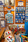 Close up tourist souvenir products on sale including fridge magnets, city of Evora, Alto Alentejo, Portugal, southern Europe