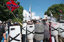 August 12, 2017 - Charlottesville, Virginia, United States - Neo-Nazis, white supremacists and other alt-right factions scuffled with counter-demonstrators near Emancipation Park (Formerly ''Lee Park'') in downtown Charlottesville, Virginia. After fighting between factions escalated, Virginia State Police ordered the evacuation by all parties and cancellation of the ''Unite The Right'' rally scheduled to take place in the park. (Credit Image: © Albin Lohr-Jones/Pacific Press via ZUMA Wire)