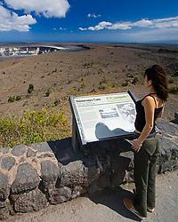 Woman visitor looking over Halemaumau or Halema`uma`u Crater, Kilauea Caldera, Hawaii, USA Volcanoes National Park, Big Island, Hawaii, USA