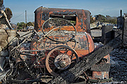 Destroyed old car near home along Kanan Dume Road. The Woolsey wildfire started on November 8, 2018 and has burned over 98,000 acres of land, destroyed an estimated 1,100 structures and killed 3 people in Los Angeles and Ventura counties and the especially hard hit area of Malibu. California, USA