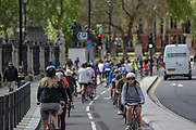The British public has been asked to self-isolate, keeping distant from others to limit the spread of the contagious COVID-19 coronavirus, but some in central London are seen not keeping the distance to one another and cyclists, in particular, seems to enjoy their sunny weather on Saturday, May 2, 2020. (Photo/Vudi Xhymshiti)