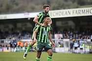 Lyle Taylor of AFC Wimbledon celebrates scoring his teams 2nd goal from a penalty to make it 1-2 with George Francomb of AFC Wimbledon (top). Skybet football league two match, Wycombe Wanderers  v AFC Wimbledon at Adams Park  in High Wycombe, Buckinghamshire on Saturday 2nd April 2016.<br /> pic by John Patrick Fletcher, Andrew Orchard sports photography.