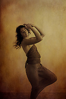 Young woman dancing in a free form graceful dance.