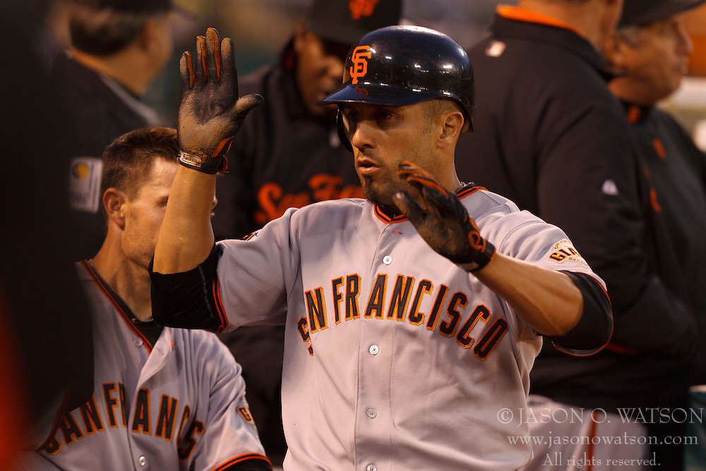 June 18, 2011; Oakland, CA, USA;  San Francisco Giants center fielder Andres Torres (56) is congratulated by teammates after scoring a run against the Oakland Athletics during the fifth inning at the O.co Coliseum.