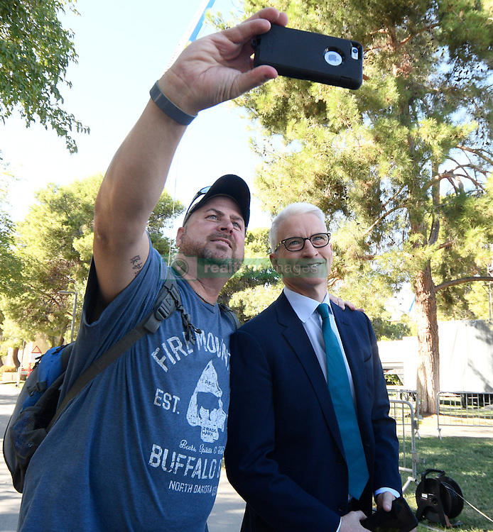 Oct. 19, 2016 - Las Vegas, Nevada, U.S. - CNN reporter ANDERSON COOPER (R) takes photos with fans rally at UNLV hours before the debate Wednesday. The third and final debate will be held Wednesday night at Las Vegas Nevada University. (Credit Image: © Gene Blevins via ZUMA Wire)