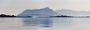 Beautiful morning panoramic view of Remøy Bridge, located on the western part of Norway. Paint effect added for artisitic expression   Nydelig morgenstemning i Nørdre Vaulen med Remøy og Leinøy på hver side av Remøybrua. Malerisk effekt er lagt til