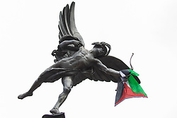 London, UK. 26th June, 2021. A Palestinian flag flies from the statue of Eros at Piccadilly Circus during the United Against The Tories national demonstration organised by the People's Assembly Against Austerity in protest against the policies of Prime Minister Boris Johnson's Conservative government. The demonstration contained blocs from organisations and groups including Palestine Solidarity Campaign, Stand Up To Racism, Stop The War Coalition, Extinction Rebellion, Kill The Bill and Black Lives Matter as well as from trade unions Unite and the CWU.