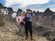 People hike in the Martial Mountains in the southern Andes to see wilderness peaks on the Canadon Negro trail, in Tierra del Fuego National Park, a day hike by ski lift above Ushuaia, Argentina, South America. The foot of South America is known as Patagonia, a name derived from coastal giants, Patagão or Patagoni, who were reported by Magellan's 1520s voyage circumnavigating the world and were actually Tehuelche native people who averaged 25 cm (or 10 inches) taller than the Spaniards. For licensing options, please inquire.