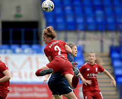 Liverpool Women's Jasmine Matthews and Manchester United Women's Lizzie Arnot contest a header during the Continental Tyres Cup, Group Two North match at Prenton Park, Birkenhead.