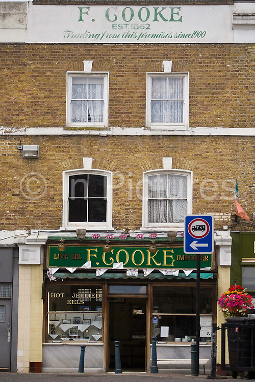 F Cooke's Pie and Mash shop in Broadway Market, Hackney, London..Eel, pie and mash shops are a traditional but dying business. Changing tastes and the scarcity of the eel has meant that the number of shops selling this traditional working class food has declined to just a handful mostly in east London. The shops were originally owned by one or two families with the earliest recorded, Manze's on Tower Bridge Road being the oldest surviving dating from 1908. Generally eels are sold cold and jellied and the meat pie and mash potato covered in a green sauce called liquor.