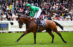 Urban Fox ridden by Jockey James Doyle goes to post for the Duke Of Cambridge Stakes