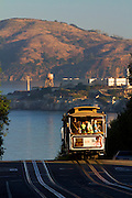 Powell-Hyde cable car with Alcatraz in the distance, San Francisco, CA