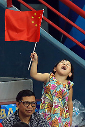 A little chinese fan celebrates and waves the China flag