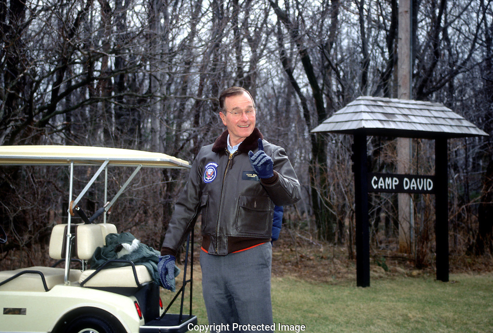 """A 29.4 MG IMAGE OF:.President Bush jokes with the """"photodogs"""" at Camp David...Photo by Dennis Brack"""