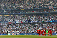 Liverpool and Tottenham Hotspur players line up before the UEFA Champions League Final match between Tottenham Hotspur and Liverpool at Wanda Metropolitano Stadium, Madrid, Spain on 1 June 2019.