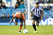 Fabian Delph of Everton and Massimo Luongo of Sheffield Wednesday contest a loose ball during the EFL Cup match between Sheffield Wednesday and Everton at Hillsborough, Sheffield, England on 24 September 2019.