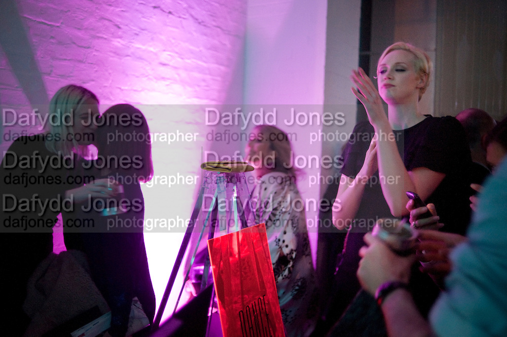 GWENDOLINE CHRISTIE, Giles Deacon after-show party. Elm lester painting rooms. Leicester Sq. London. 19 September 2011. <br /> <br />  , -DO NOT ARCHIVE-© Copyright Photograph by Dafydd Jones. 248 Clapham Rd. London SW9 0PZ. Tel 0207 820 0771. www.dafjones.com.