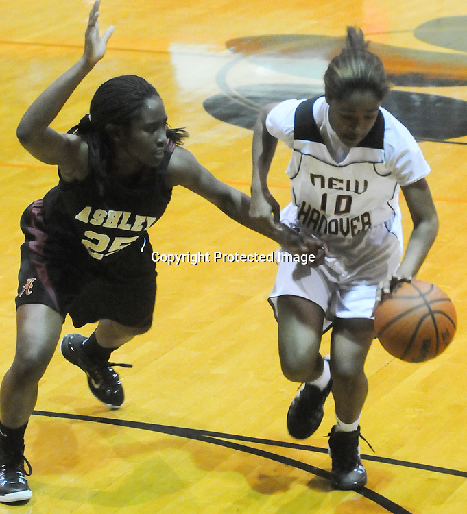 Ashley's Jada Bacchus guards New Hanover's Taylor Perkins Friday December 19, 2014 at New Hanover High School in Wilmington, N.C. (Jason A. Frizzelle)