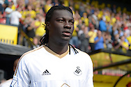 Bafetimbi Gomis of Swansea City looks on as he enters the pitch before k/o.Barclays Premier League, Watford v Swansea city at Vicarage Road in London on Saturday 12th September 2015.<br /> pic by John Patrick Fletcher, Andrew Orchard sports photography.