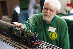 19/01/2018. London, UK. A member of the Gauge '1' Steam Locomotive Society tends to a model train at the London Model Engineering Exhibition at Alexandra Palace. Over 50 clubs and societies are exhibiting nearly 2,000 models constructed by their members. Photo credit: Rob Pinney