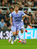 NEWCASTLE UPON TYNE, ENGLAND - SEPTEMBER 17: Patrick Bamford of Leeds United brings the ball forward during the Premier League match between Newcastle United and Leeds United at St. James Park on September 17, 2021 in Newcastle upon Tyne, England. (Photo by MB Media)